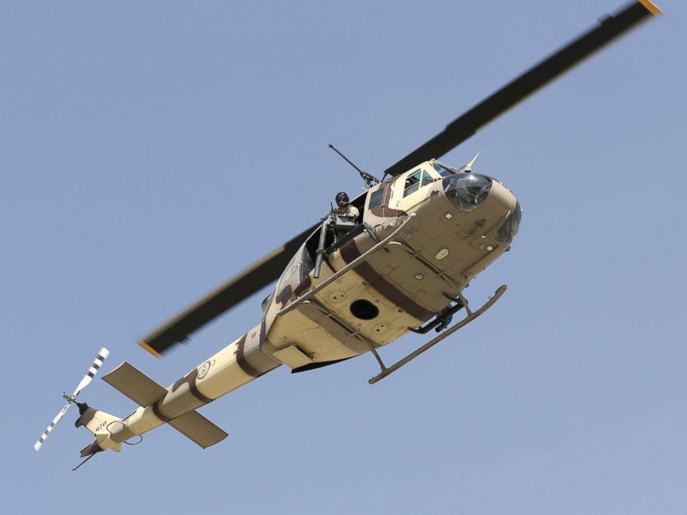 PHOTO: A U.S. UH-1N military helicotper hovers over the scene after six rockets were fired near Kabul airport following the arrival of U.S. Defense Secretary General James Mattis and NATOs Jens Stoltenberg in Kabul, Afghanistan, Sept. 27, 2017.