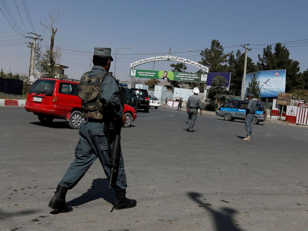 PHOTO: Afghan policemen stand guard outside of Kabul Airport after rockets exploded in Kabul, Afghanistan, Sept. 27, 2017.