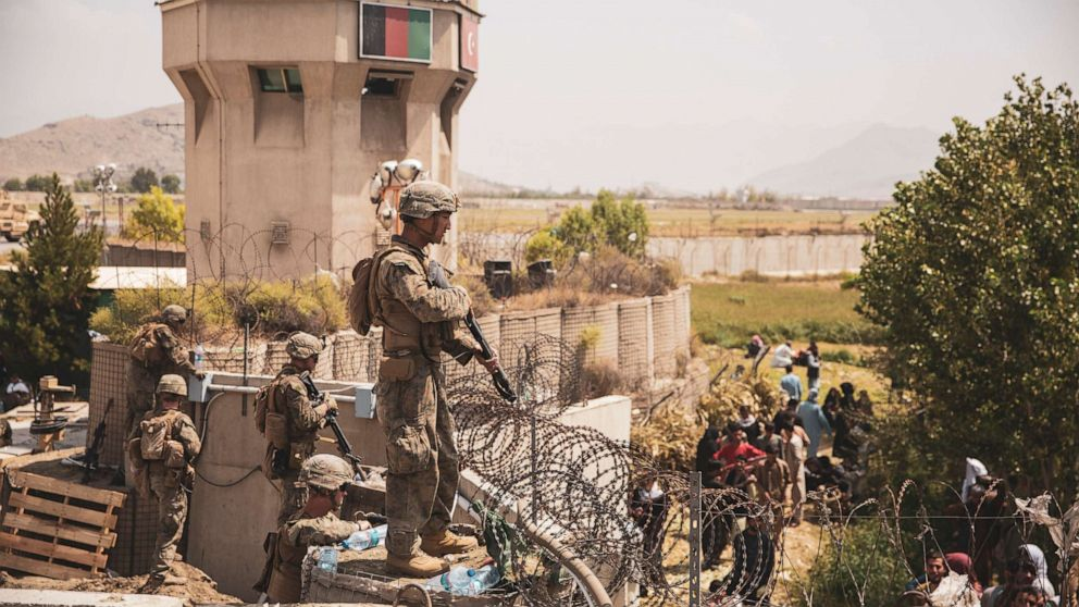 PHOTO: U.S. Marines assist with security at an Evacuation Control Checkpoint during an evacuation at Hamid Karzai International Airport, Kabul, Afghanistan, Aug. 20, 2021.