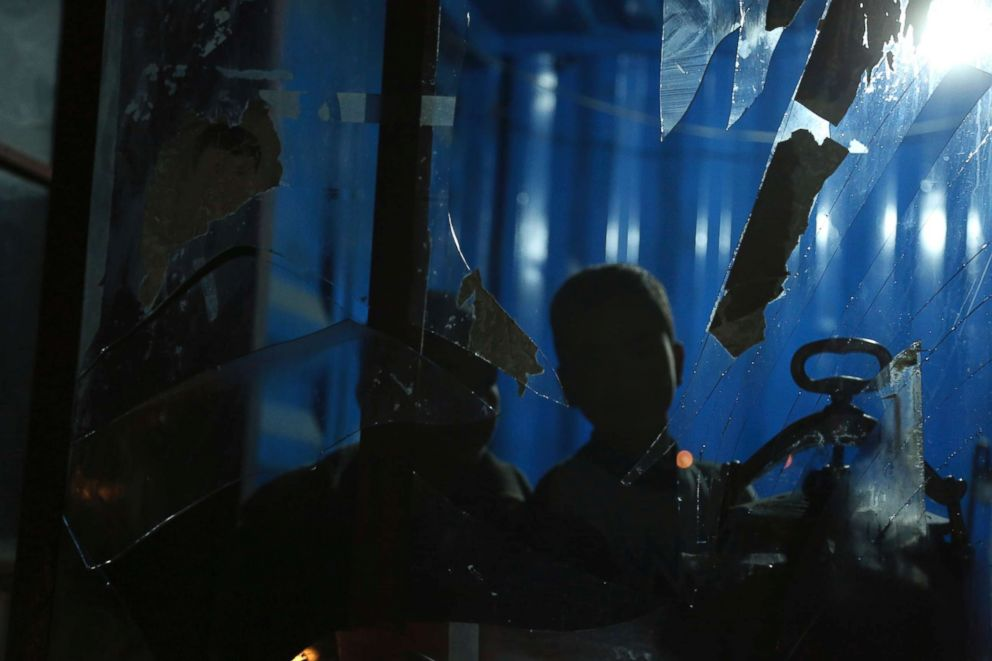 Rahmat Gul  APAfghan boys looks through a broken window of a shop after a suicide bomb attack in Kabul Afghanistan Wednesday Nov. 28 2018