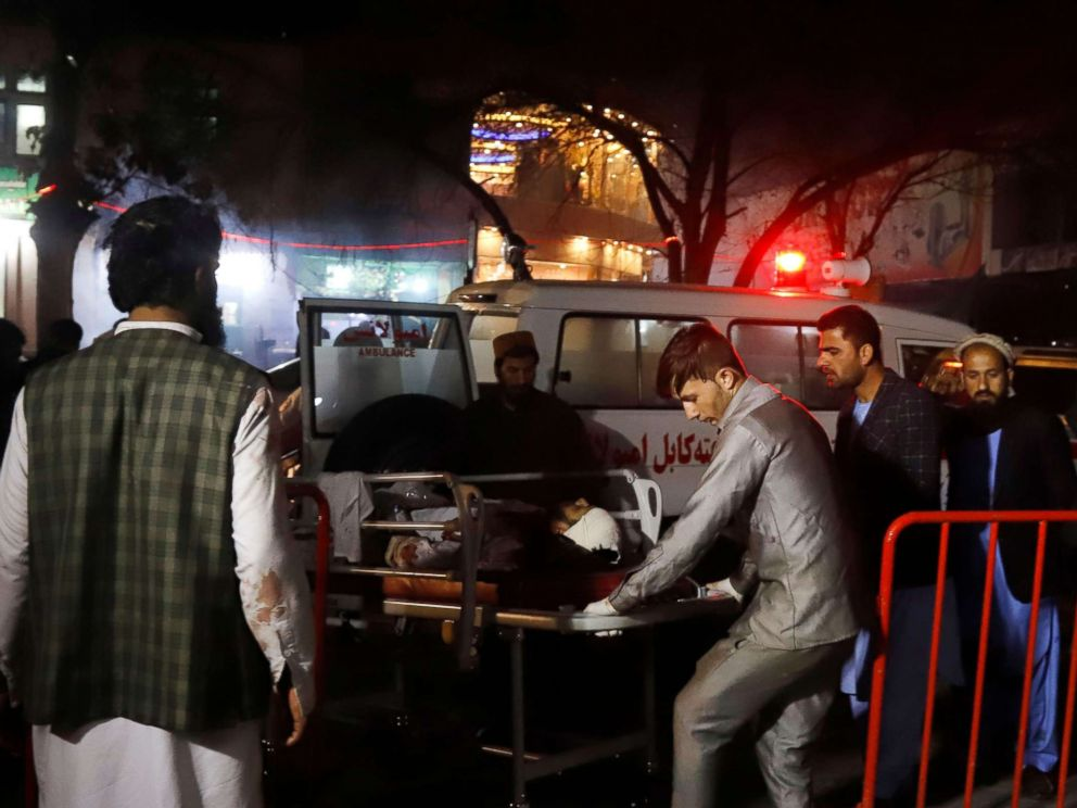 PHOTO: Afghan health workers carry an injured person after a suicide attack targeted a wedding hall in Kabul, Afghanistan, Nov. 20, 2018.
