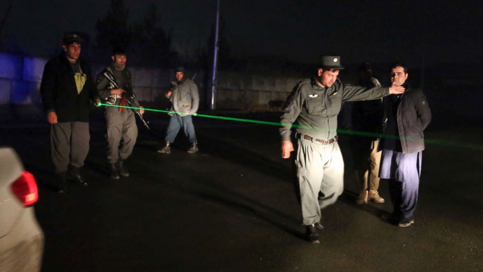Security forces block the roads at the site of a suicide bomber attack in Kabul, Afghanistan, Wednesday, Nov. 28, 2018.