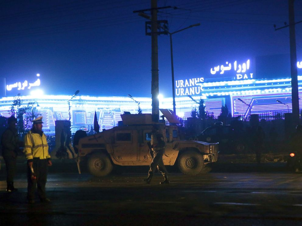 PHOTO: Security forces inspect the site of a suicide attack, happened inside a wedding hall in Kabul, Afghanistan, Nov. 20, 2018.