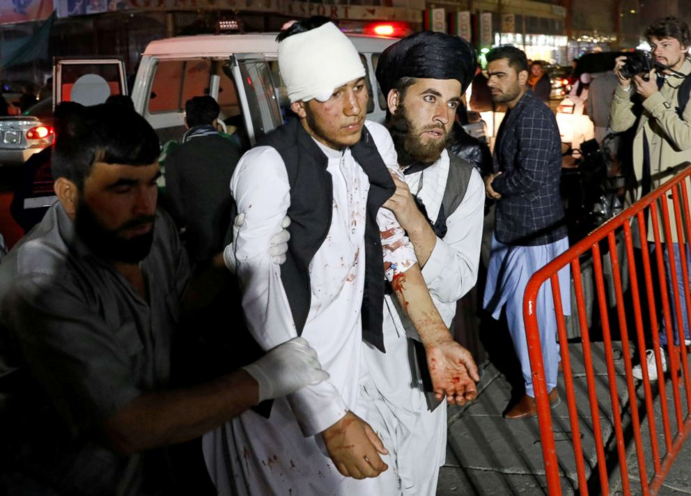 PHOTO: Afghan men carry an injured person to a hospital after a suicide attack in Kabul, Afghanistan, Nov. 20, 2018.