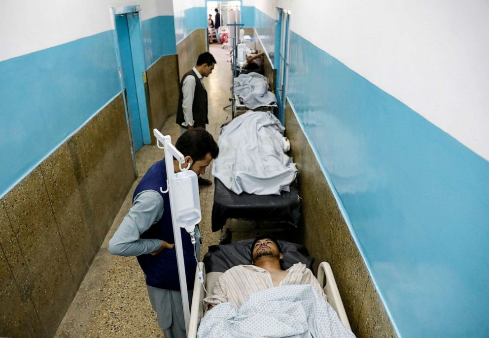 PHOTO: Injured men receive treatment in the hospital after sustaining wounds from a blast at a wedding hall in Kabul, Afghanistan, on Saturday, Aug. 18, 2019.