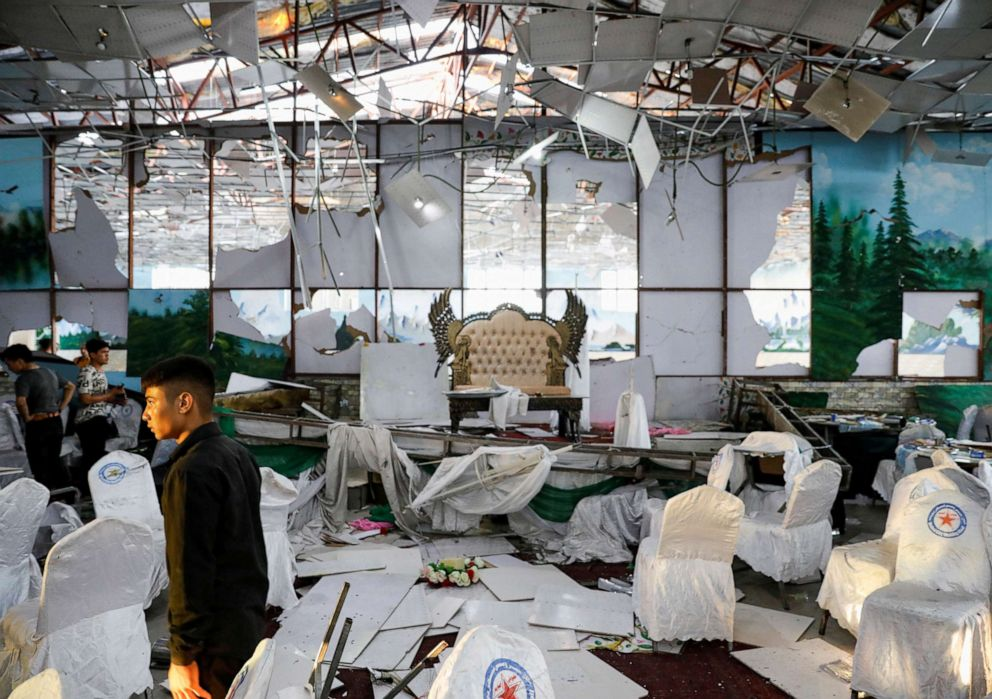 PHOTO: Workers of a wedding hall inspect after a blast in Kabul, Afghanistan, on Saturday, Aug. 18, 2019.