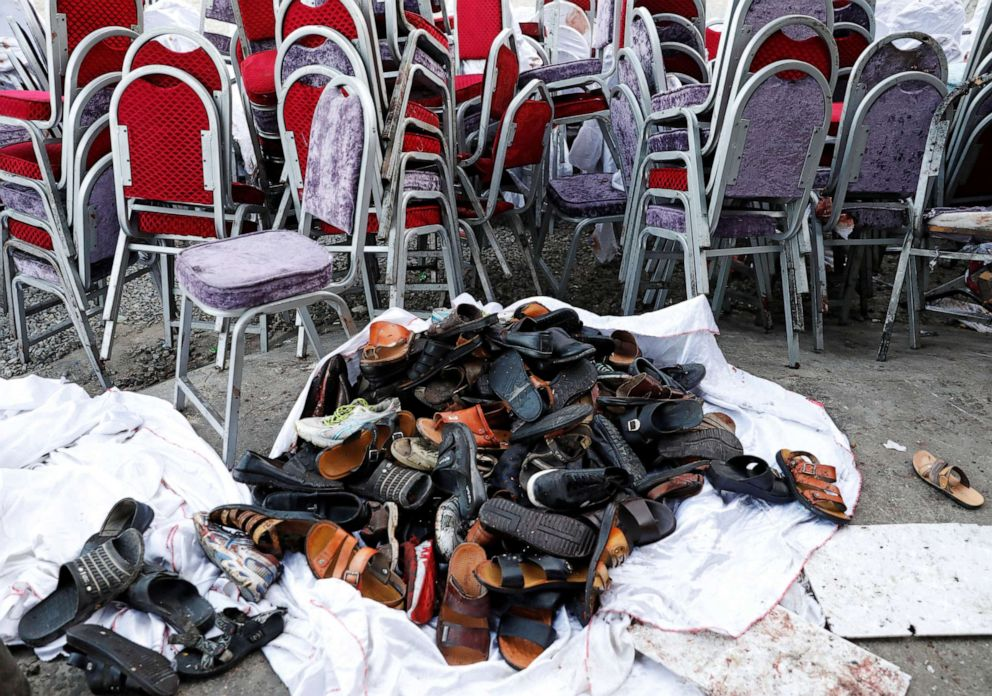 PHOTO: The shoes of victims are seen outside a damaged wedding hall after a blast in Kabul, Afghanistan, Aug. 18, 2019.