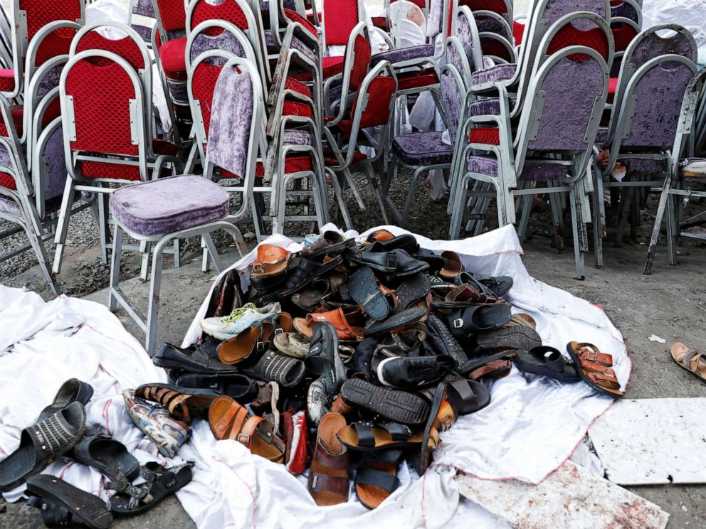 PHOTO: The shoes of victims are seen outside a damaged wedding hall after a blast in Kabul, Afghanistan, on Saturday, Aug. 18, 2019.