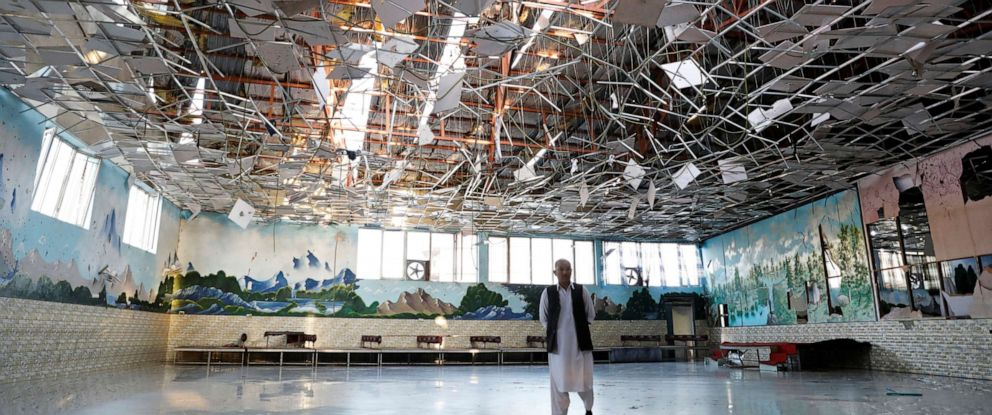 PHOTO: An Afghan man inspects a damaged wedding hall after a blast in Kabul, Afghanistan, on Saturday, Aug. 18, 2019.