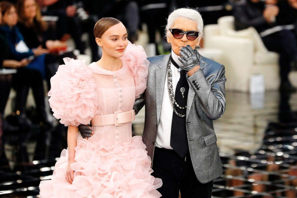 PHOTO: In this Jan. 24, 2017, file photo fashion designer Karl Lagerfeld acknowledges the audience next to Lily-Rose Melody Depp at the end of the Chanel during the 2017 spring/summer Haute Couture collection at the Grand Palais in Paris.