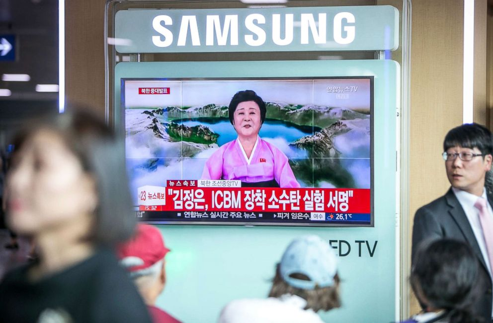 PHOTO: People watch a television screen showing an image of Ri Chun-hee, former news anchorwoman for North Korean broadcaster Korean Central Television (KCTV), during a news broadcast on North Koreas nuclear test at Seoul Station in Seoul, Sept. 3, 2017.