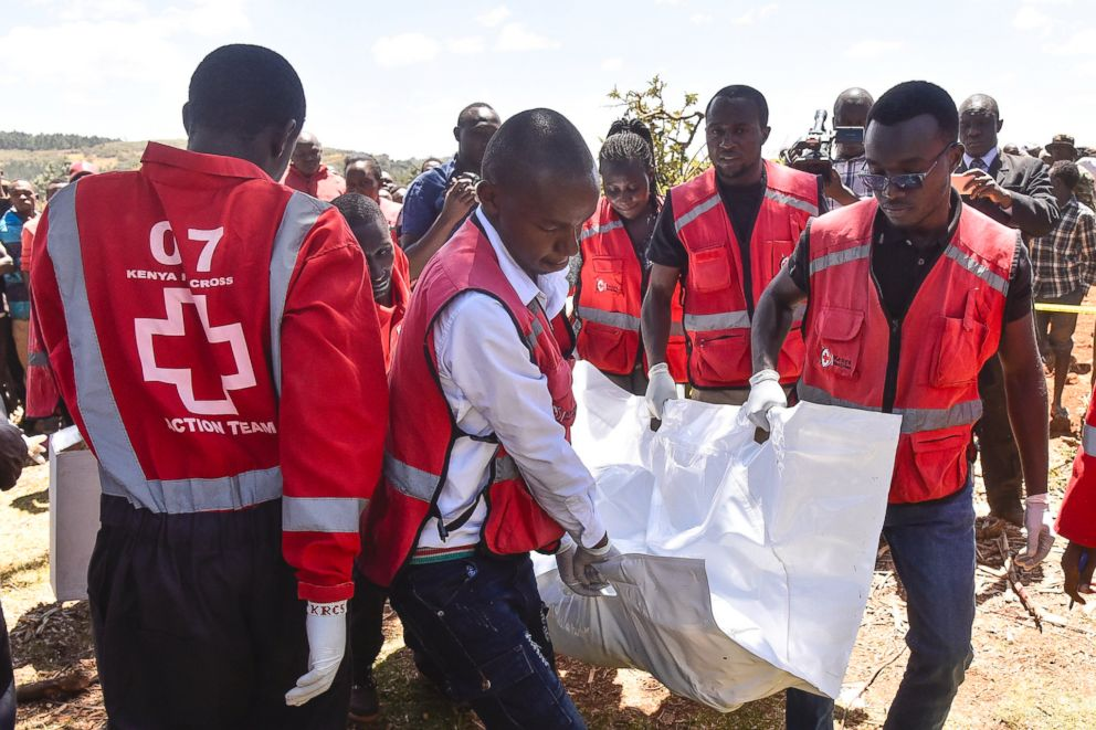 PHOTO: Members of the Kenya Red Cross carry victims bodies after a Cessna 206 light aircraft crashed at Londiani in Kericho district, Kenya, Feb. 13, 2019.