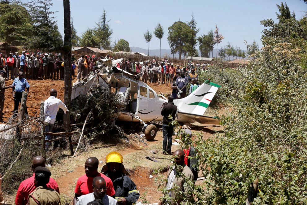 PHOTO: Rescuers and bystanders gather near the wreckage of a Cessna 206 light aircraft that crashed with its Kenyan pilot and four foreign passengers at an agricultural farm in Londiani, Kenya Feb.13, 2019.
