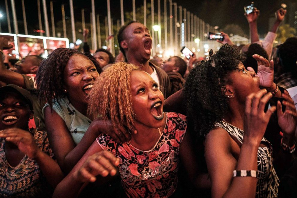 PHOTO: People react during the count down to New Years day, Jan. 1, 2018, during the New Years music event at Kenyatta International Convention Centre (KICC) in Nairobi, Kenya.
