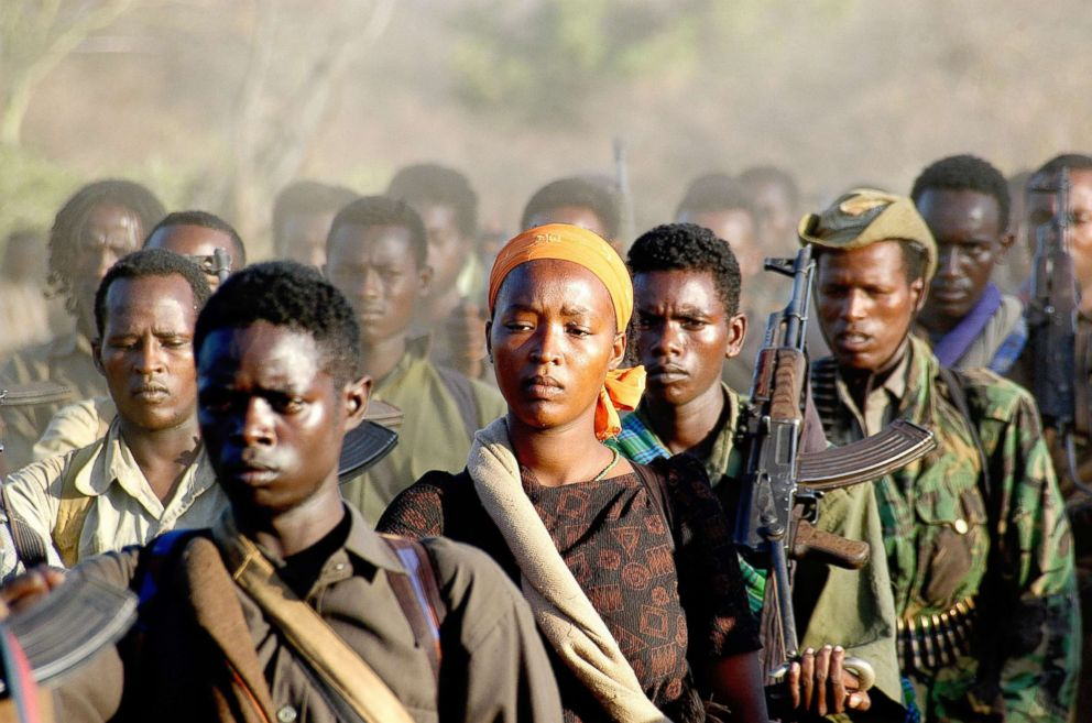 PHOTO: A female Oromo Liberation fighter is marching back to safety into Kenya with her unit.