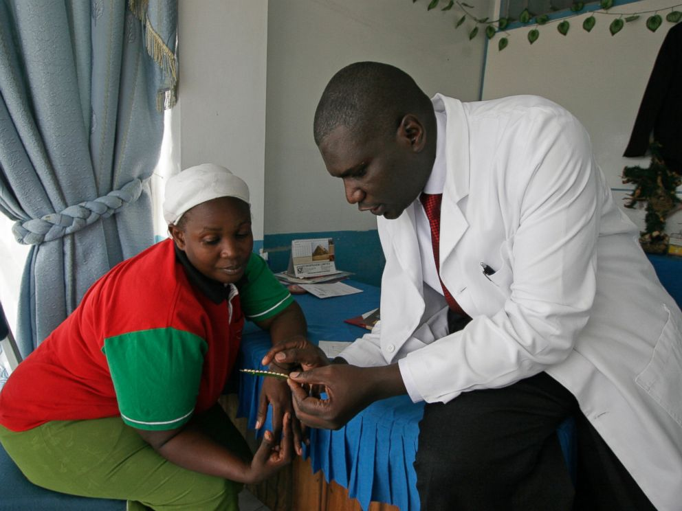 Dr. Aron Sikuku explains family planning pills to Beatrice Ravonga in Nairobi, Kenya. President Donald Trumps move a year ago to expand cuts in U.S. funding to foreign organizations providing abortion has left women without access to treatment.