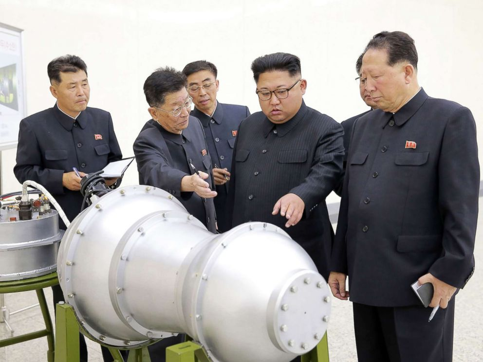 PHOTO: This undated picture released by North Koreas official Korean Central News Agency (KCNA) on Sept. 3, 2017 shows North Korean leader Kim Jong-Un (C) looking at a metal casing with two bulges at an undisclosed location.