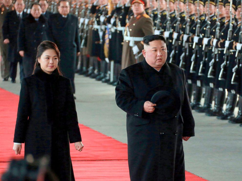 PHOTO: North Korean leader Kim Jong Un walks with his wife Ri Sol Ju at Pyongyang Station in Pyongyang, North Korea, before leaving for China, Jan. 7, 2019.