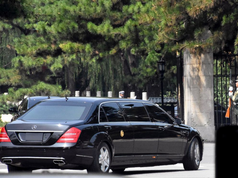A stretch limousine with a golden emblem similar to one North Korean leader Kim Jong Un has used previously, arrives with motorcycle escorts and guard of honor salute at the Diaoyutai State Guest house in Beijing, China, Tuesday, June 19, 2018.