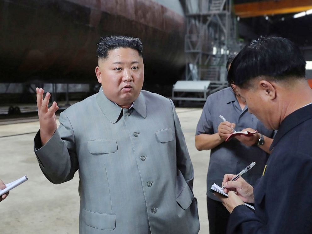 PHOTO: This undated picture released from North Koreas official Korean Central News Agency on July 23, 2019 shows North Korean leader Kim Jong Un inspecting a newly built submarine at an undisclosed location.