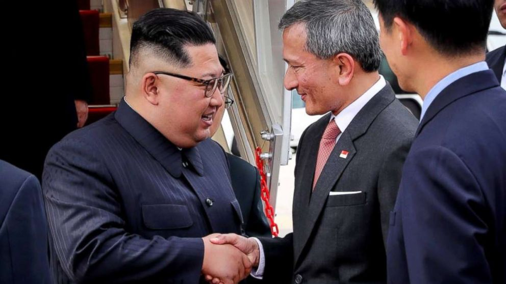 Kim Jong Un is greeted by Singapore's minister for foreign affairs, Vivian Balakrishnan, upon landing in the city-state on Sunday, June 10, 2018.