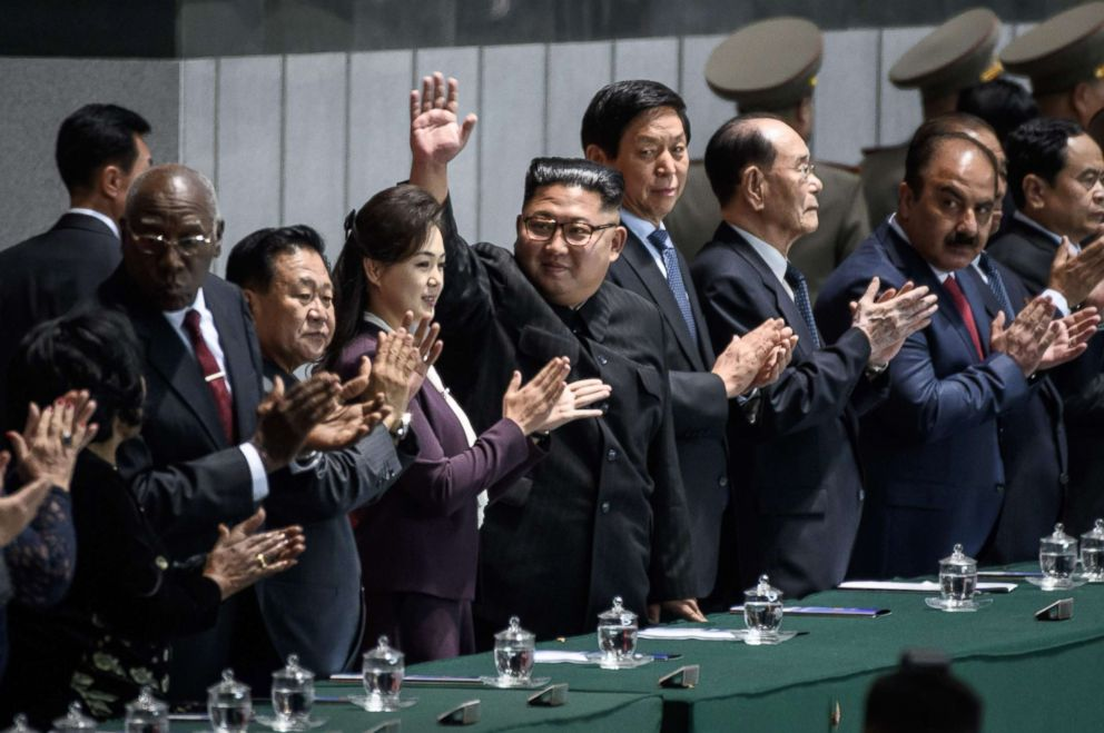PHOTO: North Koreas leader Kim Jong Un (C) waves as he stands beside Chinas Chairman of the Standing Committee of the National Peoples Congress Li Zhanshu (center R) during the Arirang Mass Games in Pyongyang, Sept. 9, 2018.