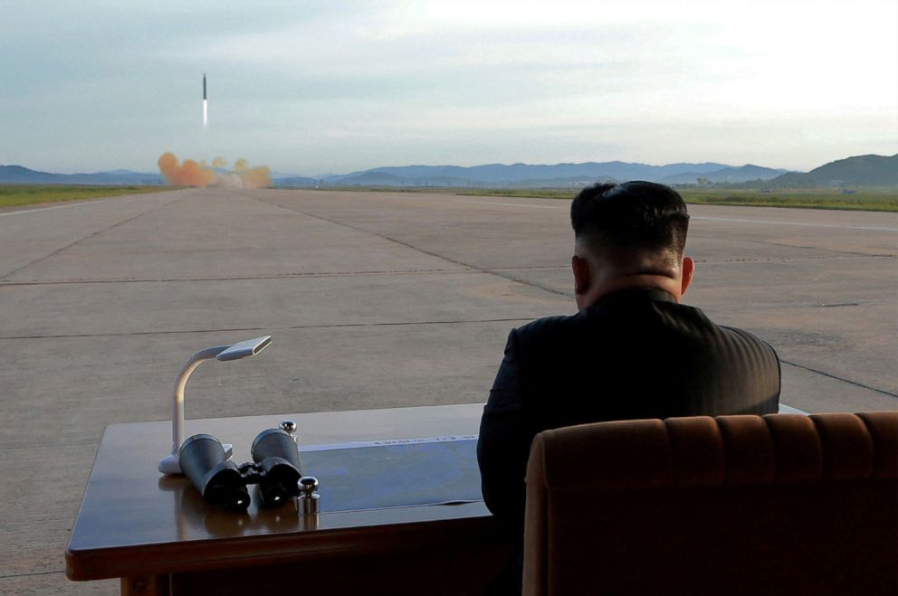 North Korean leader Kim Jong Un watches the launch of a Hwasong-12 missile in this undated photo released by North Korea's Korean Central News Agency (KCNA) on Sept. 16, 2017.