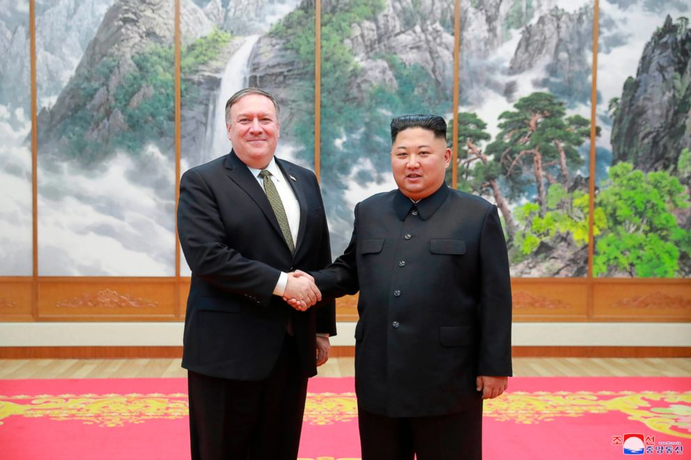 In this photo provided by the North Korean government, Secretary of State Mike Pompeo, left, shakes hands with North Korean leader Kim Jong Un as they pose for a photo in Pyongyang, North Korea, Oct. 7, 2018.