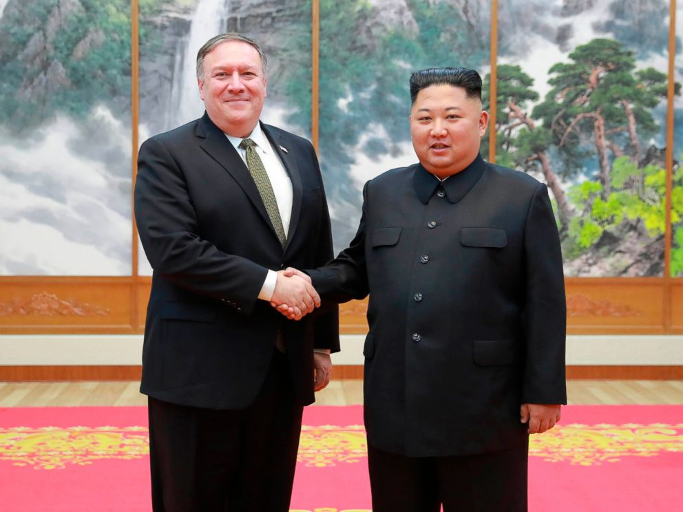 PHOTO: In this photo provided by the North Korean government, Secretary of State Mike Pompeo, left, shakes hands with North Korean leader Kim Jong Un as they pose for a photo in Pyongyang, North Korea, Oct. 7, 2018.