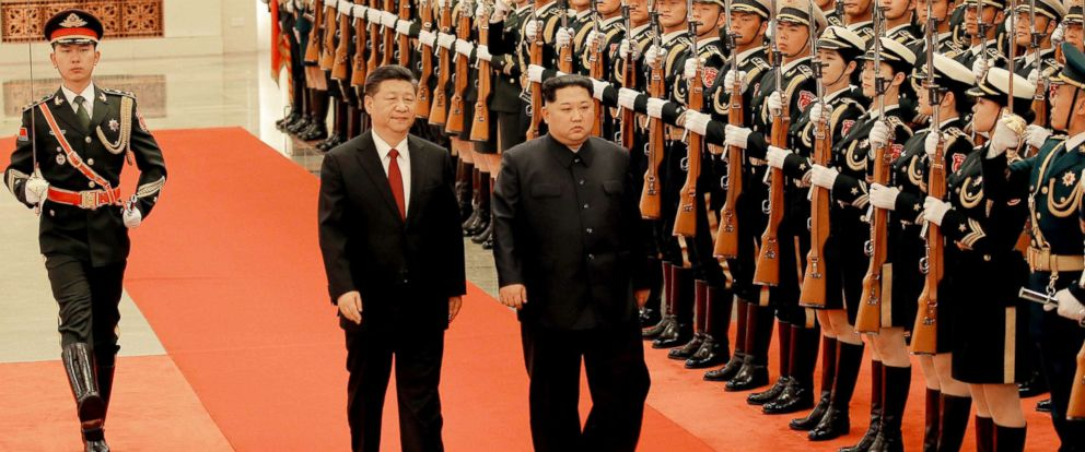 PHOTO: Chinese President Xi Jinping and North Korean leader Kim Jong Un inspect honor guards in Beijingas he paid an unofficial visit to China, in this undated photo released by North Koreas Korean Central News Agency in Pyongyang March 28, 2018.