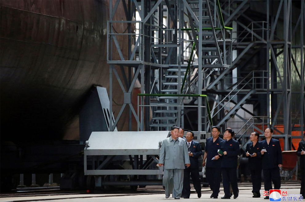 PHOTO:This undated picture released from North Koreas official Korean Central News Agency on July 23, 2019 shows North Korean leader Kim Jong Un inspecting a newly built submarine at an undisclosed location.