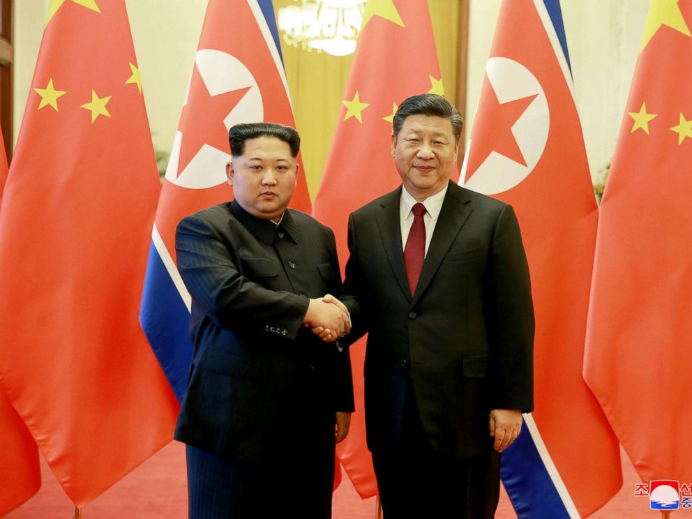 PHOTO: North Korean leader Kim Jong Un shakes hands with Chinese President Xi Jinping in Beijing as he paid an unofficial visit to China, in this undated photo released by North Koreas Korean Central News Agency in Pyongyang March 28, 2018.