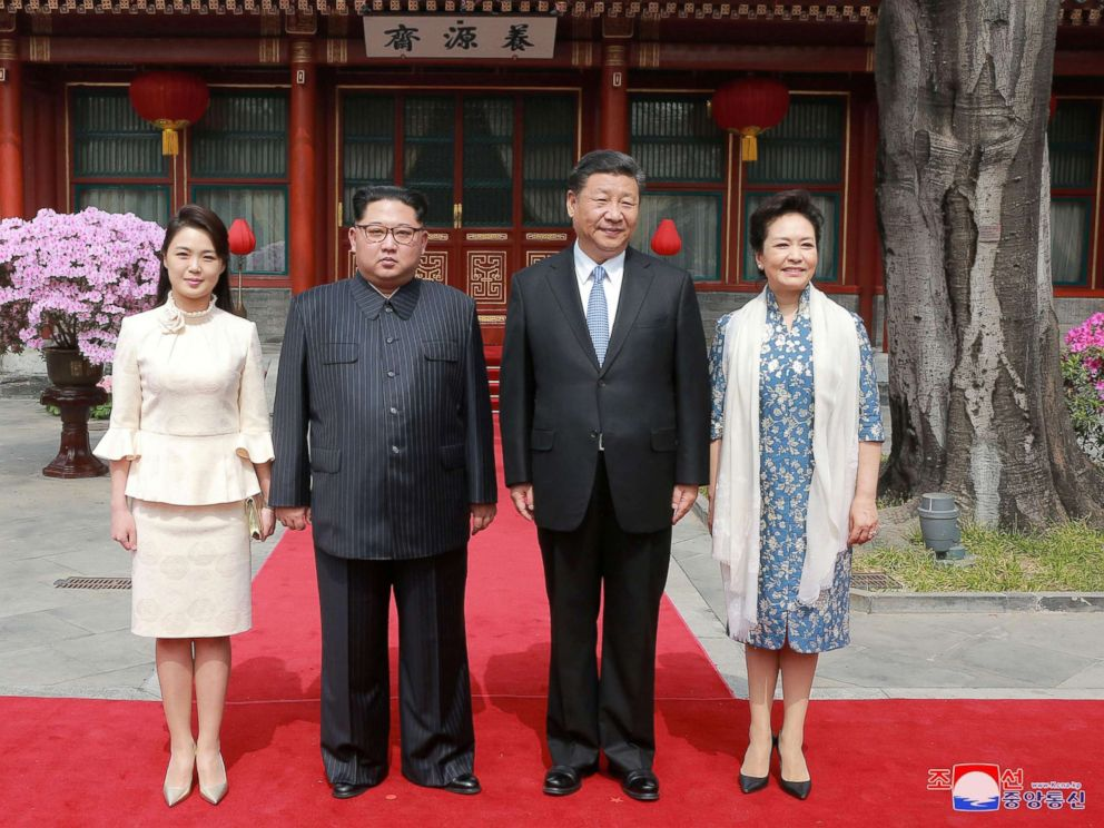 PHOTO: North Korean leader Kim Jong Un and wife Ri Sol Ju, and Chinese President Xi Jinping and wife Peng Liyuan pose for a photo in Beijing, China in this undated photo released by North Koreas Korean Central News Agency in Pyongyang March 28, 2018