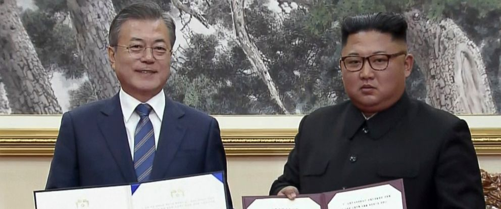 PHOTO: In this image made from video provided by Korea Broadcasting System (KBS), South Korean President Moon Jae-in, left, and North Korean leader Kim Jong Un pose after signing documents in Pyongyang, North Korea Wednesday, Sept. 19, 2018.