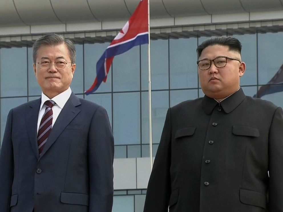 PHOTO: In this image made from video provided by Korea Broadcasting System, South Korean President Moon Jae-in, left, poses with North Korean leader Kim Jong Un for a photo on the podium upon arrival in Pyongyang, North Korea, Tuesday, Sept. 18, 2018.
