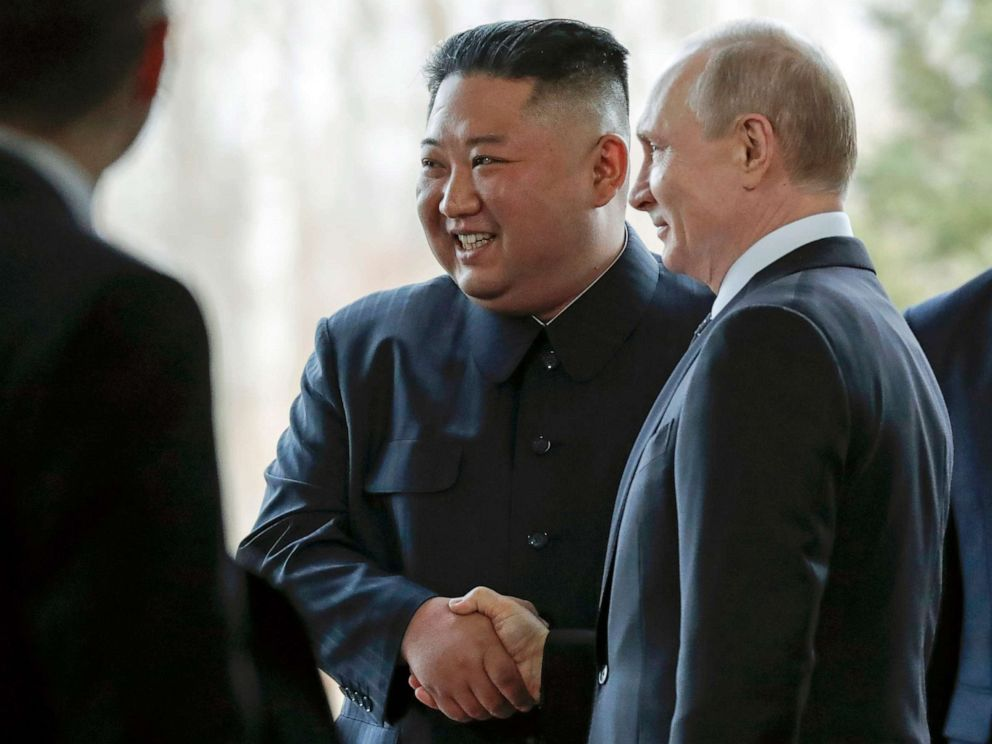 PHOTO: Russian President Vladimir Putin, right, and North Koreas leader Kim Jong Un shake hands during their meeting in Vladivostok, Russia, April 25, 2019.