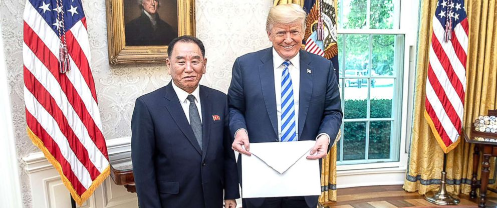 PHOTO: North Korean envoy Kim Yong Chol presents President Donald Trump with a letter from North Korean leader Kim Jong Un on June 1, 2018, in the Oval Office of the White House.