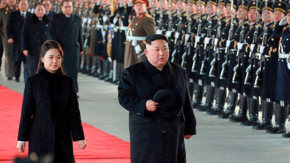 In this Monday, Jan. 7, 2019, photo provided on Tuesday, Jan. 8, 2019 by the North Korean government, North Korean leader Kim Jong Un walks with his wife Ri Sol Ju at Pyongyang Station in Pyongyang, North Korea, before leaving for China.