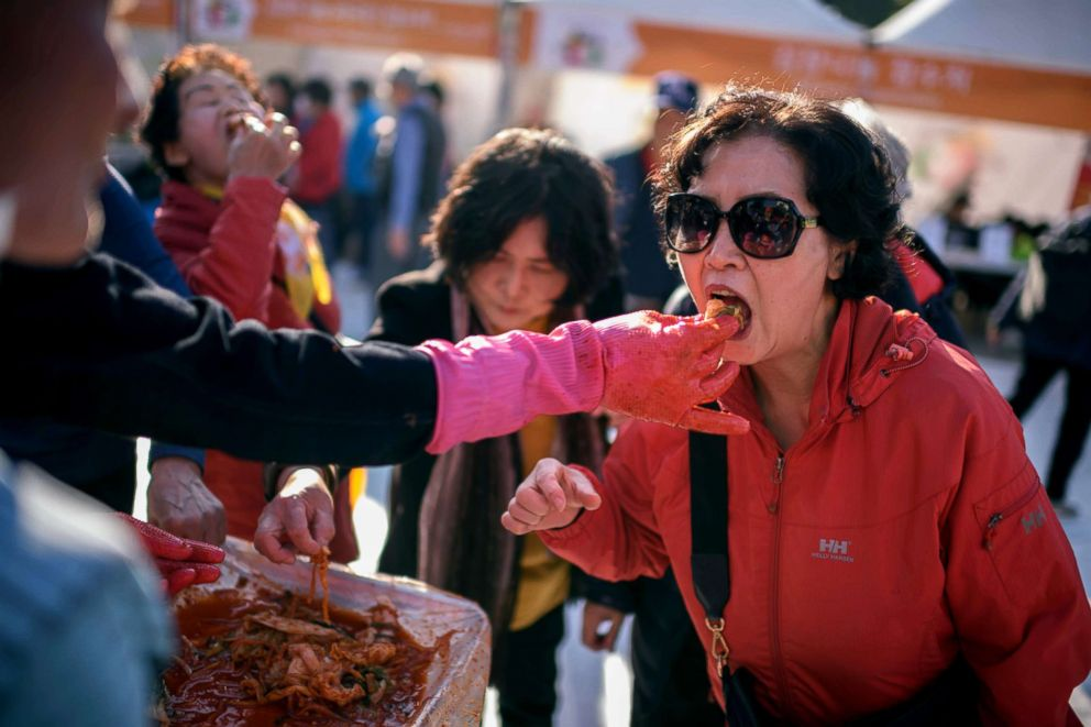PHOTO: A spectator eats kimchi during a kimchi making festival in Seoul, Nov. 2, 2018.