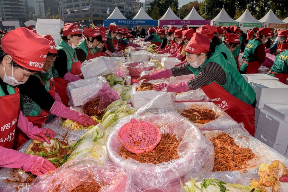 Volunteers take part in a kimchi making festival in Seoul, Nov. 2, 2018.