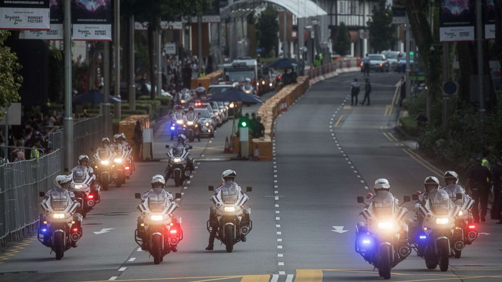 Police clear Singapore's famous Orchard Road ahead of the motorcade of North Korean leader Kim Jong-un departing the St Regis hotel for a meeting with  Singapore's Prime Minister Lee Hsien Loong, June 10, 2018 in Singapore.
