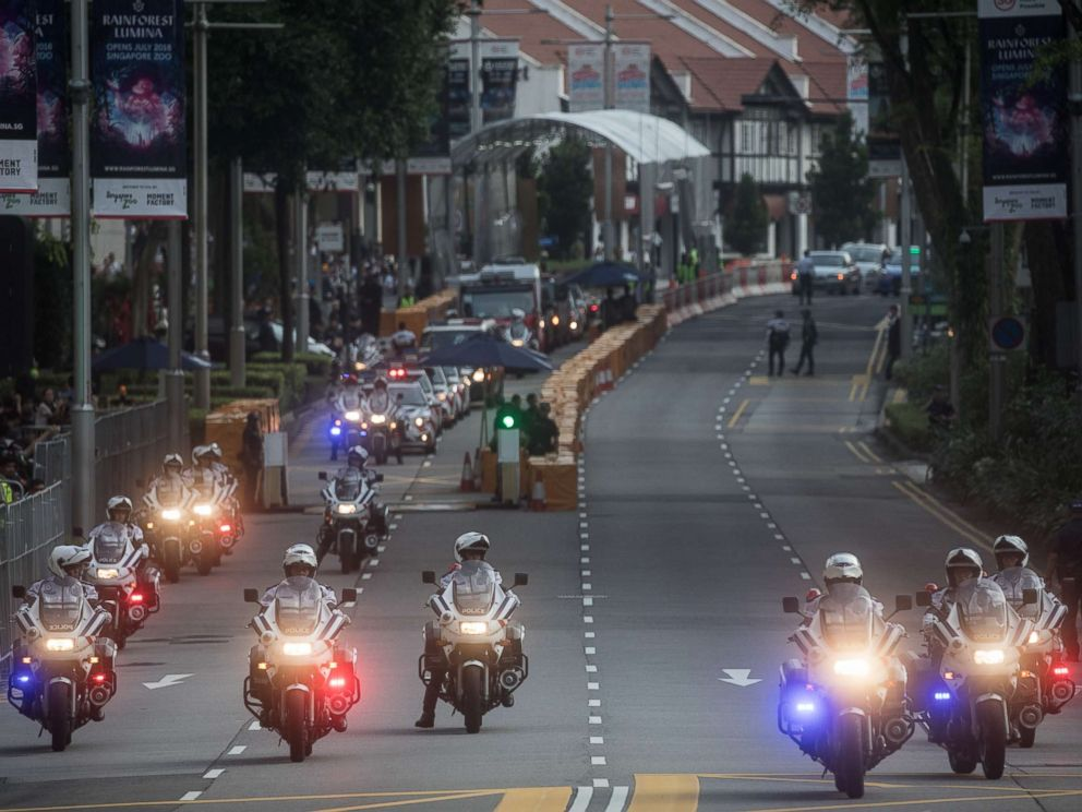 PHOTO: Police clear Singapores famous Orchard Road ahead of the motorcade of North Korean leader Kim Jong-un departing the St Regis hotel for a meeting with Singapores Prime Minister Lee Hsien Loong, June 10, 2018 in Singapore.