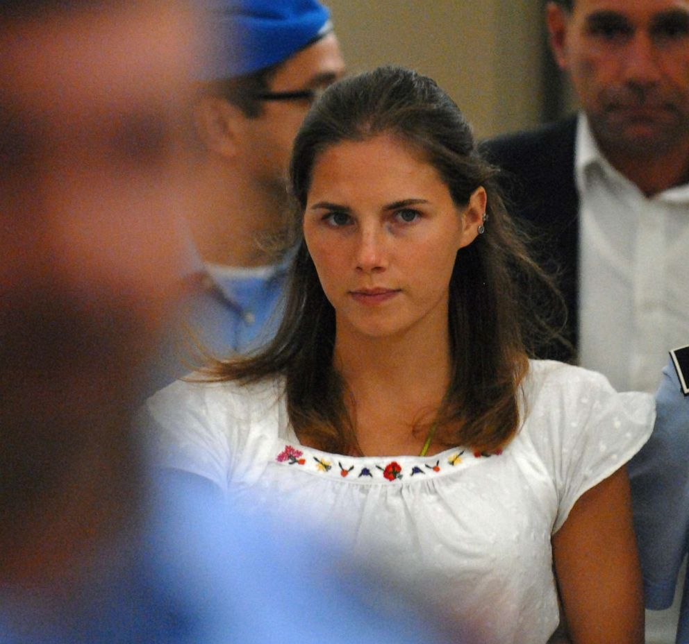 PHOTO: Amanda Knox, one of the three suspects in the murder of British student Meredith Kercher, is escorted by police upon her arrival at a court hearing in Perugia, Italy, Sept. 16, 2008.