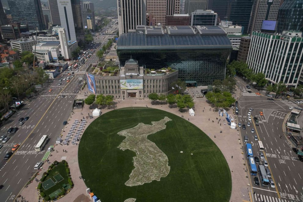 PHOTO: A general view shows a map of the Korean peninsula created using flowers by the Seoul city government to commemorate the upcoming inter-Korean summit, at Seoul city hall plaza, April 26, 2018.