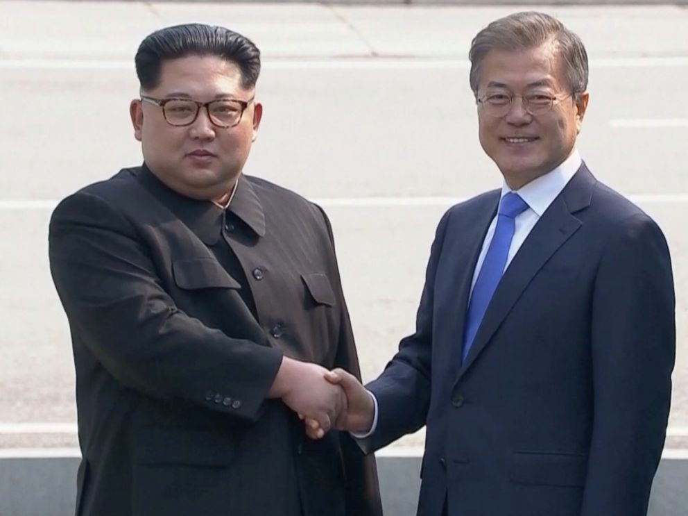 PHOTO: North Korean leader Kim Jong Un shakes hands with South Korean President Moon Jae-in as both of them arrive for the inter-Korean summit at the truce village of Panmunjom, April 27, 2018.