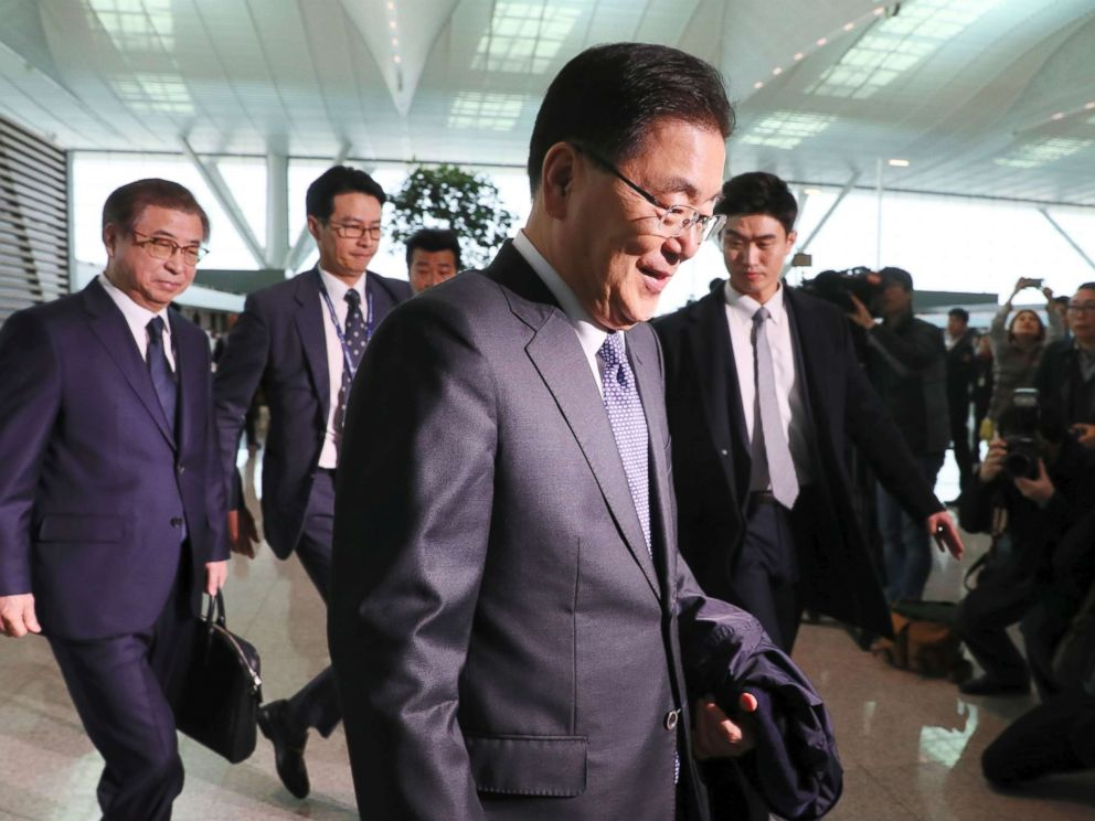PHOTO: South Koreas national security advisor Chung Eui-yong and spy chief Suh Hoon arrive at Incheon airport, west of Seoul, on March 8, 2018 to leave for Washington.