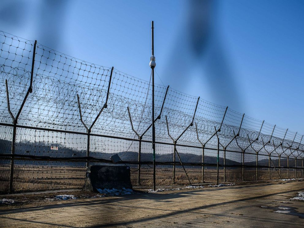 PHOTO: A barbed wire fence runs alongside the Han River near the Demilitarized Zone (DMZ) between South and North Korea, Feb, 7, 2018 near Panmunjom, South Korea.