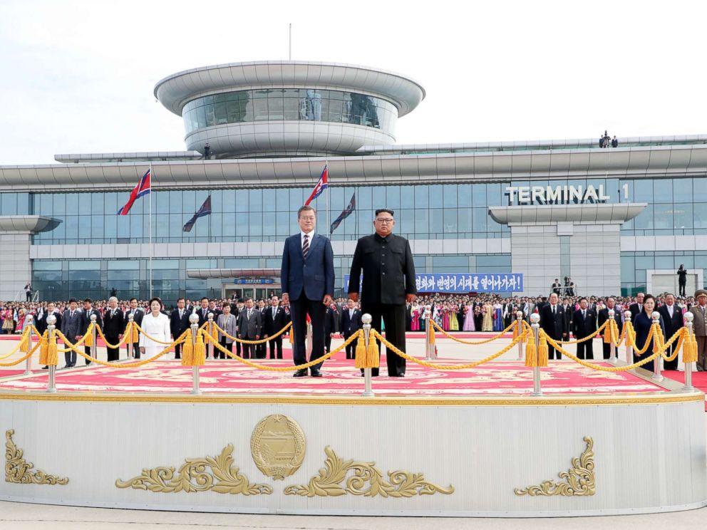 PHOTO: South Korean president Moon Jae-in and North Korean leader Kim Jong Un stand facing the honor guards ceremony at Sunan International Airport, Pyongyang North Korea. Sep 18, 2018.