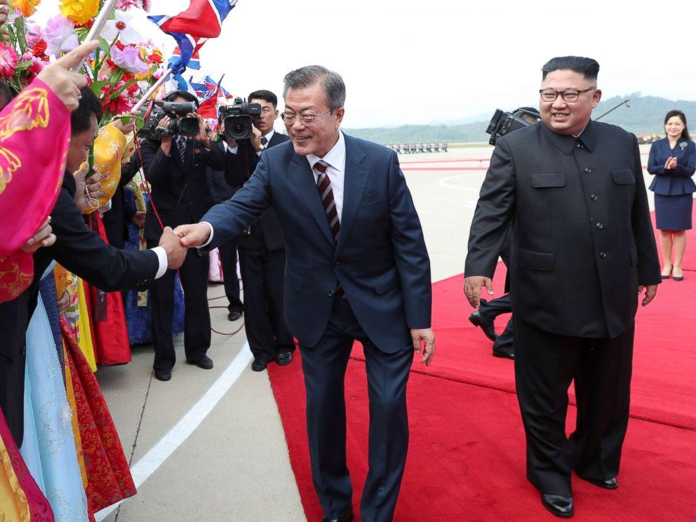 South Korean president Moon Jae-in and North Korean leader Kim Jong Un greet North Korean citizens at Sunan International Airport, Pyongyang North Korea. Sep 18, 2018.