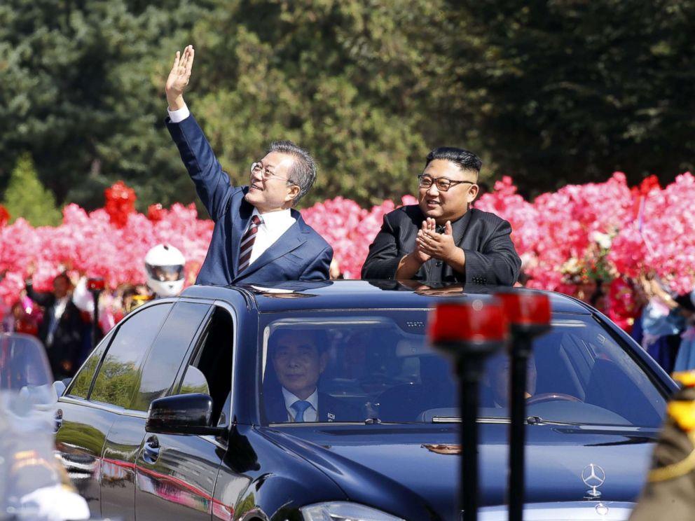 North Korean leader Kim Jong Un and South Korean president Moon Jae-in wave to North Korean citizens at a parade in Pyongyang, North Korea. Sep 18, 2018.